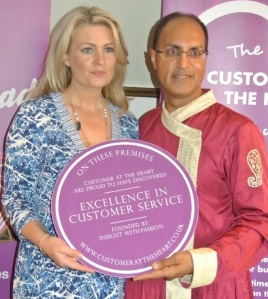 Menston restaurant '1875' owner Manjinder Singh Sarai receiving the 'Excellence in Customer Service' award from Kate Hardcastle