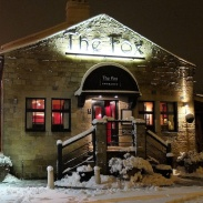 Menston village pub: the Fox entrance on a winter evening