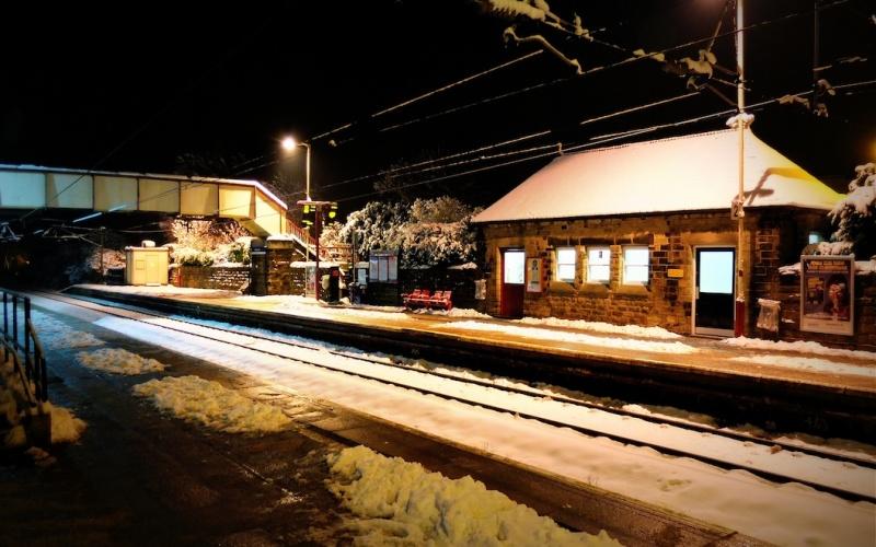 Menston village railway station on a winter evening