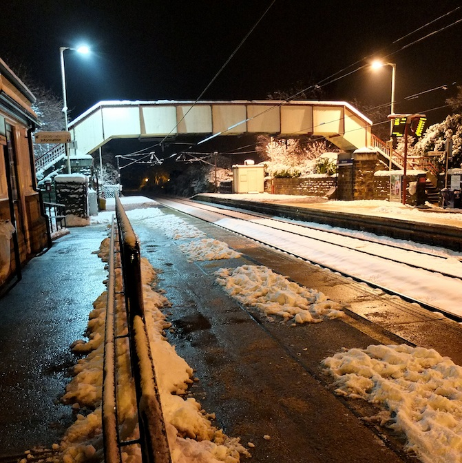 Menston railway station looking towards Ilkley on a winter evening