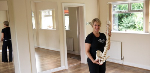 Menston village Pilates studio with Christine North-Minchella with a model of the spine