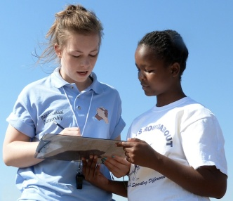 St Mary's Menston pupil Emily Fieldhouse managing the sports field with an African pupil