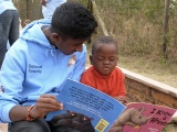 St Mary's pupil Kavindu Appuhamy gives an African child a lesson about rhinos, or is it the other way round?