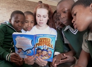 St Mary's pupil Hannah Smith reading about football in South Africa