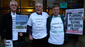 Steve Ellams, Roger Livesey and Alan Elsegood make the case with banners and T-shirts outside City Hall before Steve's presentation