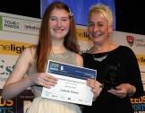 Isobel Palmer displaying her award