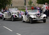 A classic and a classi-looking 'kit car' at the Jubilee celebrations