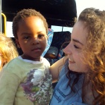 St Mary's Menston pupil Olivia Leonard with a Zulu child