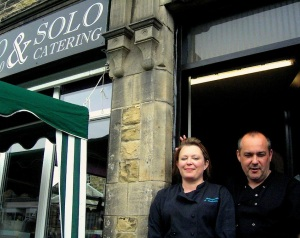 Hosts Audra and Gareth at Solo, their delicatessen/pavement cafe, which will become a 'bistro', open late, for the weekend of the Grand Depart