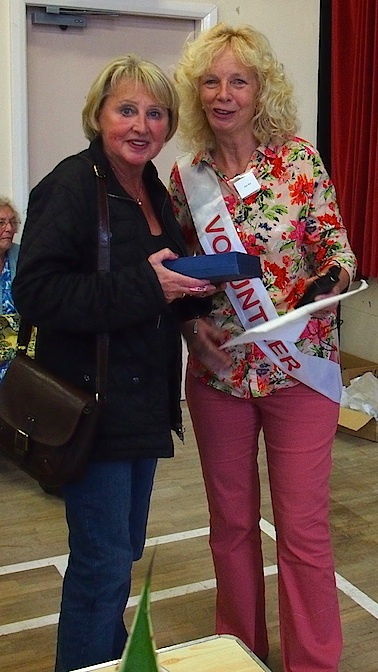 Carol O'Brian receives the Rose Wood Trophy for the best single rose