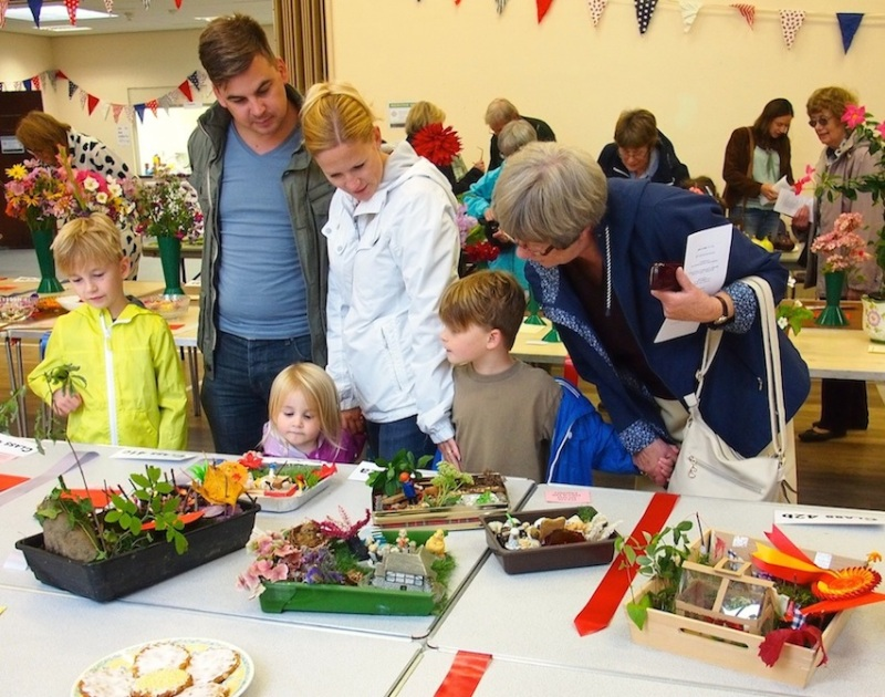 Children and parents fascinated by the miniature gardens made by children