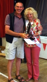 Geoff Lomas receives the Wharfedale Fuschia Society Trophy from Show President
