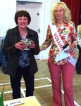 Judith Knaggs receives the Joan Pullan Cup for Flower Arrangement from Show President. One arrangement had a WW1 commemorations theme