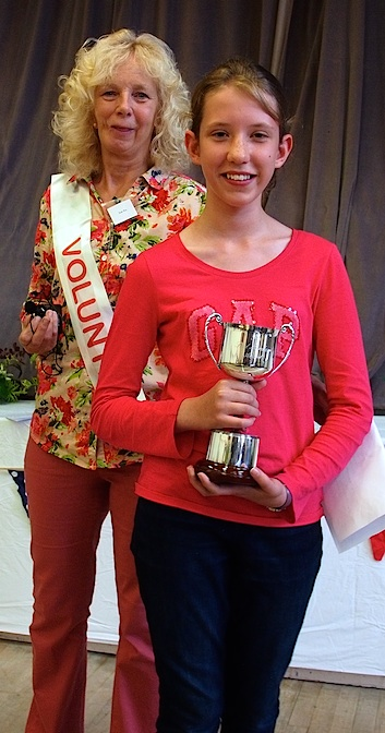 Maria Sage receiving the Fred Marcham Junior Cup for Needlework/Embroidery from Show President