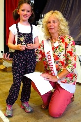 Matilda Irving receives the cup for children's handicrafts from Show President