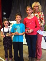 Matilda Irving, Owen Sage and Maria Sage with their Children's Cups for floral art, novelty and baking