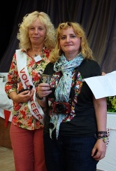 Winner of the Menston Show Photography Cup, Petronela Prisca, receives the trophy from Show President Cllr Sue Rix