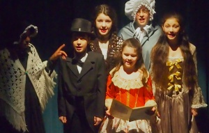 Chorus in performance of 'A Christmas Carol' by  Bradford Theatre Arts at the Bradford Playhouse, December 2014