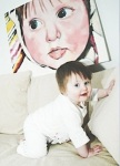 Photo of baby Lucinda with a painting of her