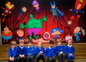 A large mural at Menston Primary Schoolwith some of the pupils who helped to create it