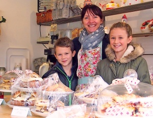 A smiling welcome from the new owner of the Village Bakery, and two cheerful helpers Kate and William