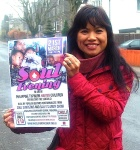 Beth Street with the poster for the Soul Evening on 21 March, to raise money to build a school destroyed by typhoon Haiyan