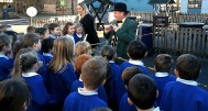 Dr Who talking to the children of Menston Primary School
