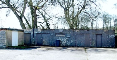 The Low Hall Road side of the eyesore building at the side of Menston Park, behind the Scout hut.