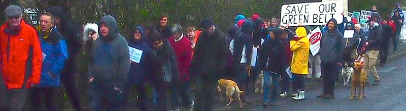 The walkers on Ings Lane approaching the proposed development site on Green Belt land