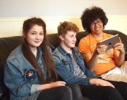 Three of the 'eggs2iPads' project 'teachers': Hattie Barnes, Luke Guzder and Shaun Street, having fun with an iPad