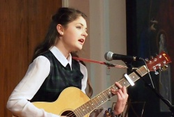 Hattie Barnes, with her guitar, performing at the recent 'Bambisanani' concert at St Mary's Menston
