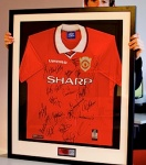 Framed Manchester United shirt, signed by the 199 team