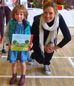 Four year old Beatrice wth her book, prize in show sponsors Ribston Pippin's competition