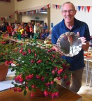 A happy man: Geoff Lomas with his winning fuschias