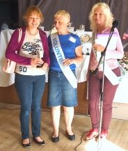 Elizabeth Forder, who took the top fruit and vegetable prize, with Show Chairman Sue Richmond and President Sue Rix