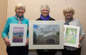 Ann Wade (Chair), Pat Hargreaves and Judy Illingworth, each with one of their works