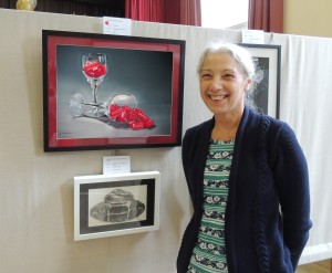 Christine Thomas with her pastel 'Two glasses of red', voted favourite by visitors