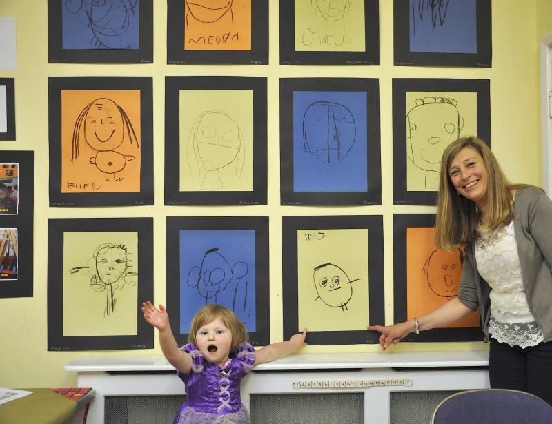 A display of Preschool selfies with pupil Iris Roberts and Joint Exhibition Secretary Sara Hargreaves
