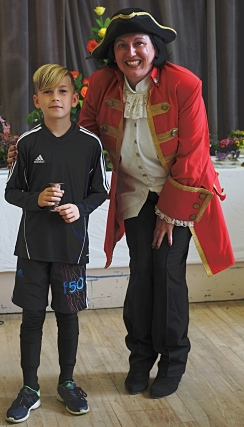 Billy Barker with the 7-10 years Children's Cup for Floral Art, Novelty and Baking. With town crier