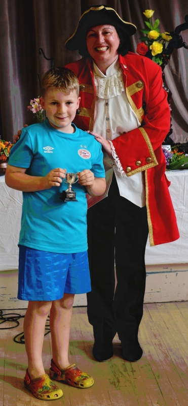 Bobby Carter with the Junior Photography Cup. With town crier.