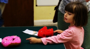 Young girl admiring a handicrafts entry