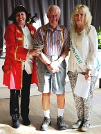 Overall Show winner, Dougie Ascough, with Show President Sue Rix (right) and Barnoldswick town crier Elisa Mowe.