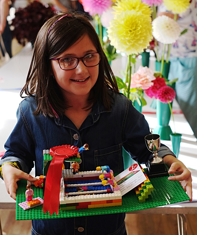 Elisa Burns with her Lego swimming pool which gained her the 7-10 years handicrafts best in class jointly with Lucy McNabb