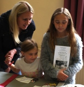 Mum and two daughters admiring the matchbox entries