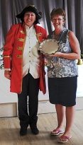 Anne Lomas with the Leslie Wood Memorial Trophy for Best in Show for her entry in the embroidery/tapesty/cross stitch class.With town crier
