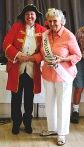 Elizabeth Loy with the Joan Pullan Cup for flower arrangement. She also gained the Rose Wood Trophy for the best single rose. With town crier.