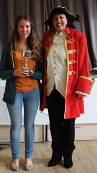 Maria Sage with the Fred Marcham Cup for needlework/embroidery. With Town Crier Elisa Mowe