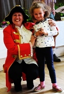 Sophie McNabb, who won the 6 years and under cup for floral art, novelty and baking, with Town Crier