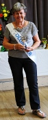 Sue Lee holding the Norman Hunt Cup for home produce