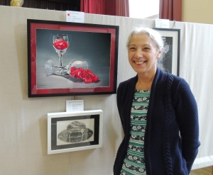 Christine Thomas with her painting 'Rwo glasses of red'